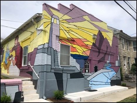 Building with colorful lighthouse mural covering the entire side