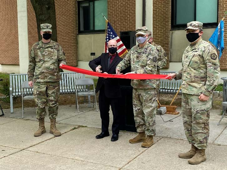Ribbon cutting ceremony with military personnel